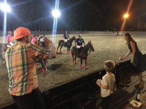 family enjoying arena polo match