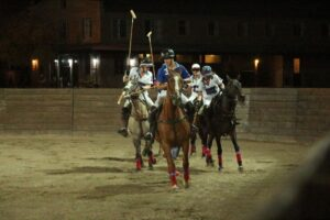 people playing arena polo at night